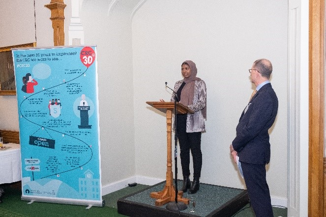 Fowiza and Siham speaking at a lectern
