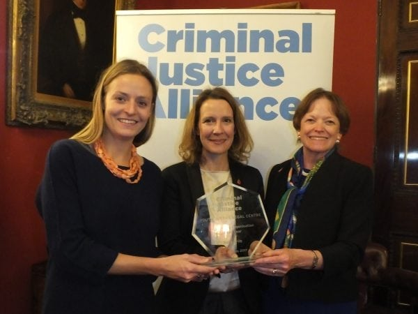 Members of the YJLC team collecting the award from Dame Glenys Stacey